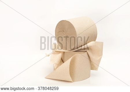 Unwound Paper Roll. Two Rolls Of Paper. Simple Toilet Paper On A White Background. A Skein Of Paper
