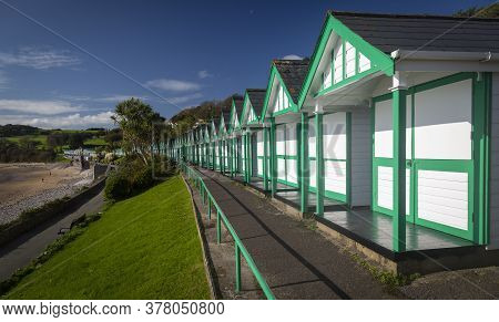 Editorial Swansea, Uk - October 21, 2019: Small Wooden Chalet Huts On Langland Bay On The Gower Coas
