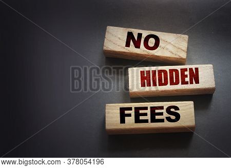 No Hidden Fees Word On Wood Blocks. Taxes And Fees Financial Business Concept