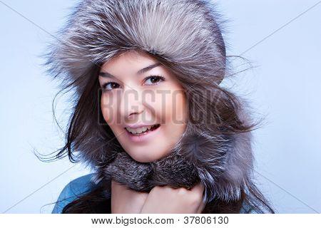 smiling winter woman in fur cap
