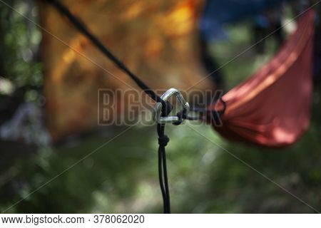 Hammock Mount. The Carabiner Secures The Rope. Tourist Affiliation. Strong Grip.