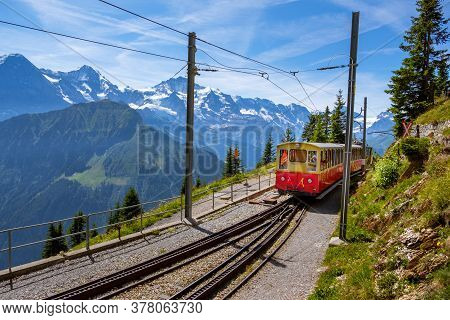 Schynige Platte, Bernese Oberland, Switzerland - August 1 2019 : Tourist Train Near The Station Of S