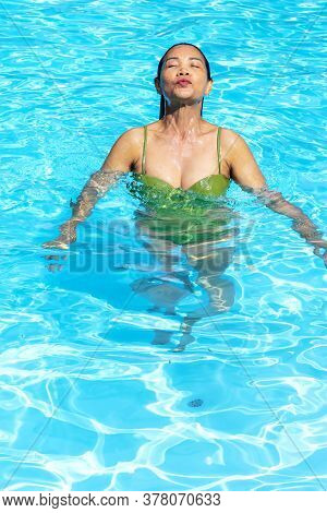 Woman Enjoy In Swimming Pool At Beach Koh Chang Thailand. Koh Chang Is Located In The Eastern Gulf O