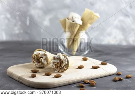 Ice Cream Background. Fresh Ice Cream For Dessert. Ice Cream With Almonds On A Wooden Board. Almond