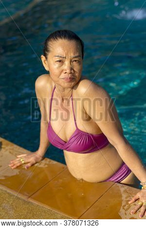 Woman Traveler With Bikini On Pool  At Beach Koh Chang Thailand. Koh Chang Is Located In The Eastern