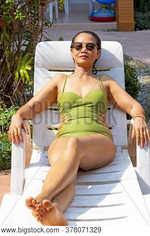 Woman Relax In Sun Lounger On Swimming Pool At Beach Koh Chang Thailand. Koh Chang Is Located In The