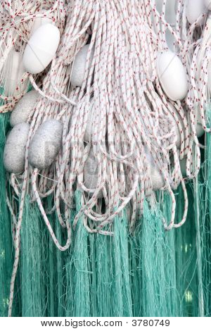 fishing net with floats in close up poster