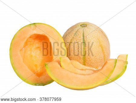 Whole Ripe Cantaloupe Next To Half Cantaloupe Cute Lengthwise, Seeds Removed With Slices Of Remainin