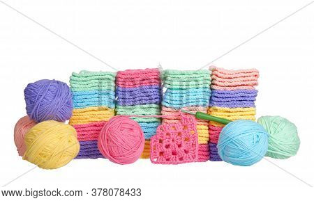 Piles Of Colorful Hand Crochet Granny Squares With Balls Of Yarn Piled Behind, Crochet Hook Laying I
