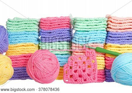 Close Up On Piles Of Colorful Hand Crochet Granny Squares With Balls Of Yarn Piled Behind, Crochet H
