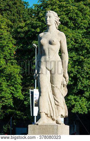 Woman Statue In Geneva In Switzerland - City Of Geneva, Switzerland - July 8, 2020