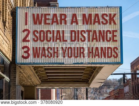 Mockup Of Movie Cinema Billboard With Wear A Mask, Social Distance And Wash Hands To Deal With The C