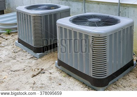 Air Conditioning System Unit Installed Outside Facade Of The House
