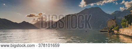 Panorama Of Kotor Bay Or Boka Kotorska With Mountains, Crystal Clear Water And An Old Stone House In