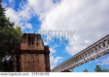 Concrete Pylon Part Of An Old Railway Bridge No Longer Used Left Standing Beside New Railroad Tracks