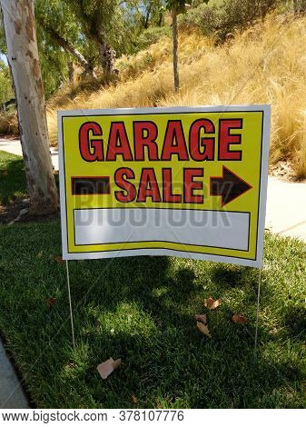 Garage Sale Sign Posted On The Roadside