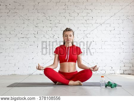 A Young Girl Is Engaged In Yoga. Lotus Position, Meditation And Calmness.