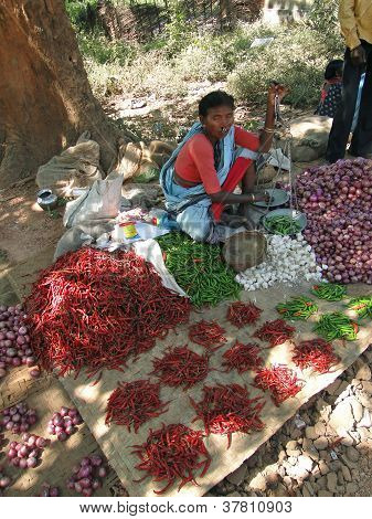 Indian Woman Sells Red Peppers