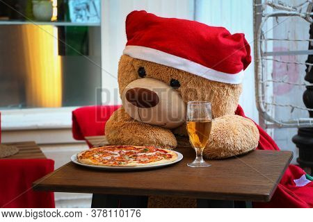 Funny Plush Bear Eating Pizza And Drinking Beer, Alone At His Table