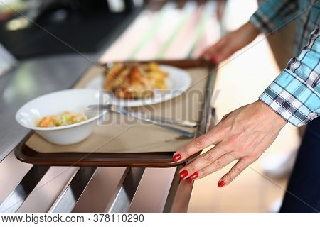 Woman Move Food Tray In Self-service Restaurant. Food Chain With Professional Cooks And Great Food.