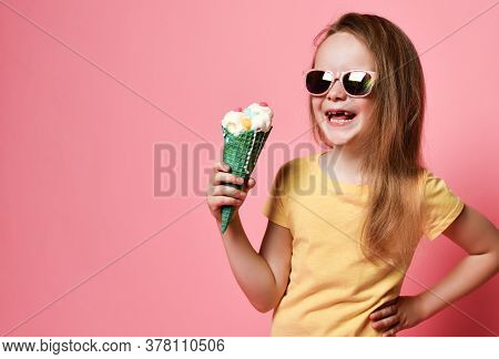 Happy Laughing Frolic Kid Girl In Yellow T-shirt And Sunglasses Holds Big Vanilla Ice Cream With Can