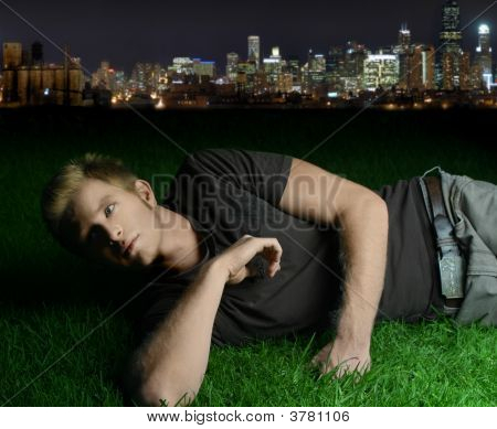 Young Man Laying On Grass