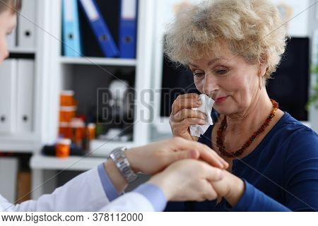 Elderly Woman Is Upset At Doctor Appointment And Wipe Her Tears With Napkin. Doctor Announced Diagno