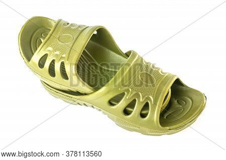 Pair Of Cheap Durable Yellow Rubber Slippers One Inside Other Isolated On White Background.