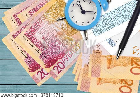 20 Belorussian Rubles Bills And Alarm Clock With Pen And Envelopes. Tax Season Concept, Payment Dead