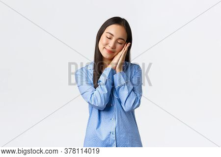Smiling Tender Asian Girl Took Off Makeup, Wear Pajamas And Going To Sleep. Woman In Blue Jammies Cl