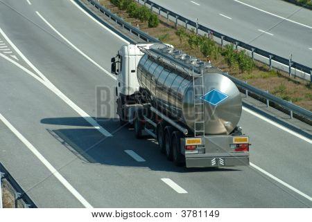 Tanker Truck Rolling On Highway