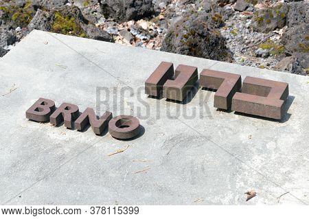 Belzec, Poland - June 12, 2020: Brno Iscription In Yiddish And Polish Language At Belzec Exterminati