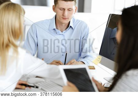 Group Of Business People Discussing Questions At Meeting. Headshot Of Casual Dressed Businessman Usi