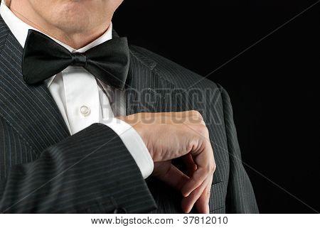 Man In Tux Tucks In Pocket Square