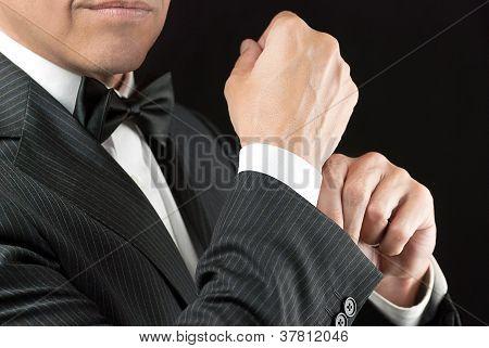 Man In Tux Fixes Cufflink