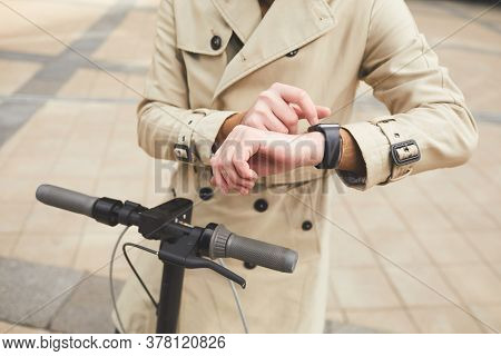 Cropped Portrait Of Unrecognizable Businessman Wearing Trenchcoat And Checking Time While Riding Ele