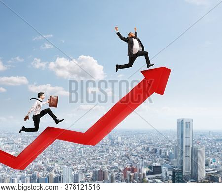 Businessmen Run To Reach The Best Results Over A Growing Red Statistic Arrow. Concept Of Success
