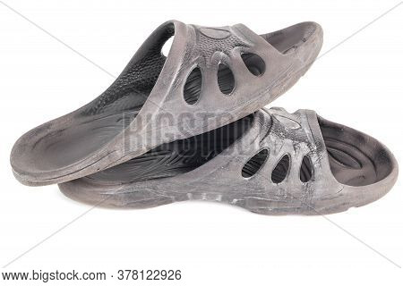 Pair Of Used Cheap Black Soft Rubber Slippers With Signs Od Friction Wear Isolated On White Backgrou