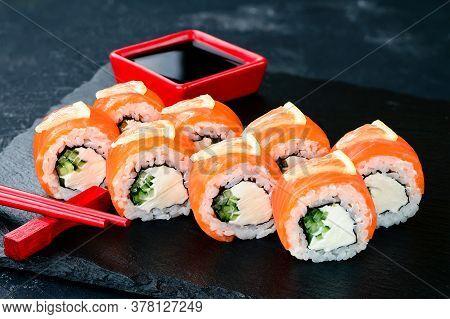 Philadelphia Maki Sushi Made Of Fresh Raw Salmon, Cream Cheese And Cucumber, Salmon Sushi Rolls On A