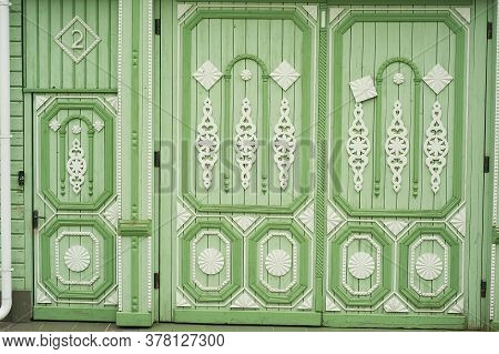 Wooden Wide Gates In Old Russian Houses. Figurative Ornaments Made Of Wood. Bright Colors. Ancient W