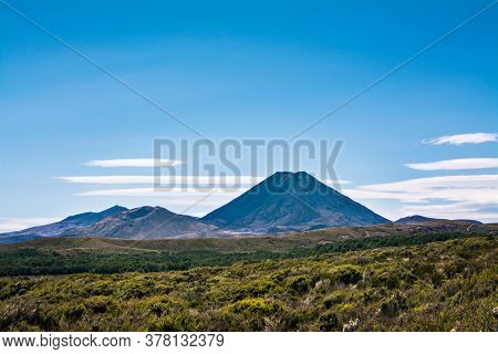 Volcanic Cone Of Mount Ngauruhoe Rising Over Flat Plateau On A Fine Summer Day