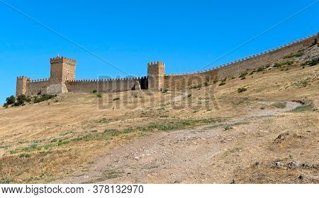 Ancient Historic Genoese Castle Or Fortress On Crest Of Mountain