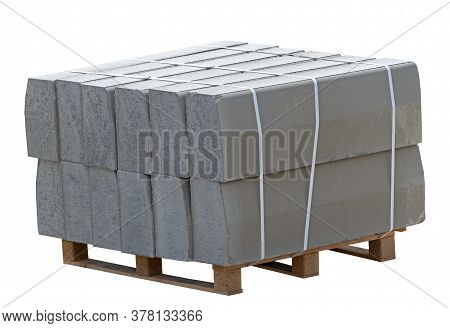 The Pallet With A Stack Of Concrete Curbstone On White Background