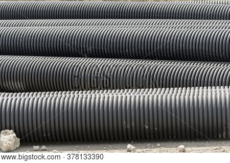 Black Plastic Pipes For Water Supply Or Sewerage Prepared For Installation Or Repair Of The Water Su