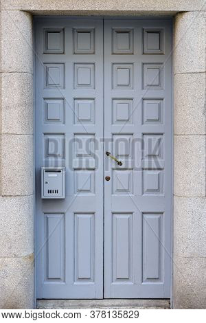 Old Gray Wooden Door With Mailbox Close Up