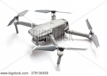 Modern Drone Quadcopter With A Camera Isolated On White Background