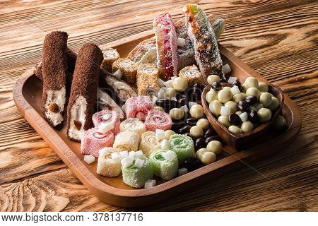 Oriental Sweets, Nuts And Dried Fruits, Set Of Sweet Candies With Nuts And Candied Fruits On A Woode