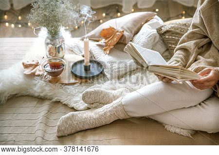 Cozy Autumn At Home, A Woman With Tea And A Book.