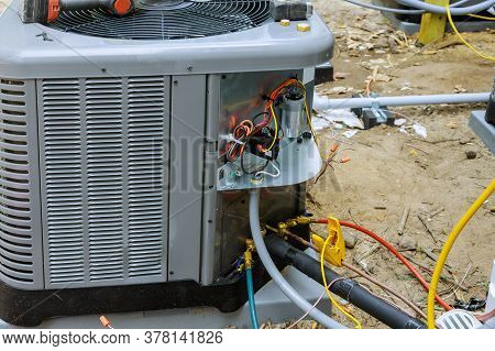 Air Conditioning Technician Servicing Of Preparing To Install New Air Conditioner