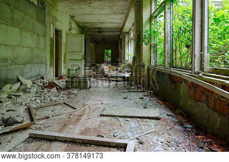 Devastation In Corridor Of Abandoned School In Large Resettled Village Of Pogonnoye In Exclusion Zon